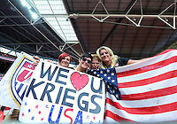 August 09, 2012: Supporters of United States Women's soccer team hold signs during Football Final match at the Wembley Stadium on day thirteen in Wembley, England. USA defeat Japan 2-1 to win it's third consecutive Olympic gold medal in women's soccer. ..