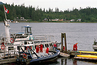 Tourists returning to Ucluelet from a Whale Watching Trip, overlooking the First Nations Village of Ittatsoo, Vancouver Island, British Columbia, Canada