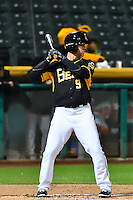 Todd Cunningham (9) of the Salt Lake Bees at bat against the Fresno Grizzlies in Pacific Coast League action at Smith's Ballpark on April 13, 2016 in Salt Lake City, Utah.  The Grizzlies defeated the Bees 6-0.  (Stephen Smith/Four Seam Images)