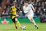 Mateo Kovacic of Real Madrid (R) in action against Borussia Dortmund Midfielder Christian Pulisic (L) during the Europe Champions League 2017-18 match between Real Madrid and Borussia Dortmund at Santiago Bernabeu Stadium on 06 December 2017 in Madrid Spain. Photo by Diego Gonzalez / Power Sport Images