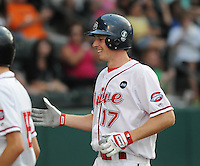 July 25, 2009: Greenville Drive right fielder Mitch Dening (17) is congratulated after hitting a home run against the Delmarva Shorebirds in a game at Fluor Field at the West End in Greenville, S.C. Photo by: Tom Priddy/Four Seam Images