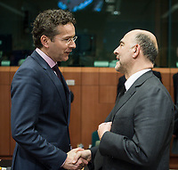 Eurogroup President Dutch Finance Minister Jeroen Dijsselbloem (L) and Pierre Moscovici , EU commissioner for Economic and financial affairs, taxation and customs union  at the start of a Eurogroup with European Finance Ministers meeting at EU council headquarters in Brussels, Belgium on 26.01.2015 The Eurogroup's meeting focus on Greece, after  leftist anti-bailout party SYRIZA won parliamentary elections by Wiktor Dabkowski