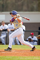 Austin Neary (33) of the Western Carolina Catamounts follows through on his swing against the Davidson Wildcats at Wilson Field on March 10, 2013 in Davidson, North Carolina.  The Catamounts defeated the Wildcats 5-2.  (Brian Westerholt/Four Seam Images)