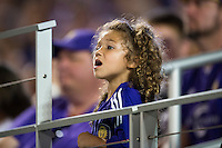 Orlando, Florida - Saturday, April 23, 2016: A young Orlando Pride fan watches the action during an NWSL match between Orlando Pride and Houston Dash at the Orlando Citrus Bowl.