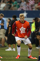 Brek Shea #23 of the USMNT warms up before taking the field against Honduras on July 24, 2013 at Dallas Cowboys Stadium in Arlington, TX. USMNT won 3-1.