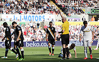 Pictured: Match referee Lee Mason (yellow) shows Sascha Rietner of Fulham (7) a yellow card for his foul against Ben Davies who is on the ground. Sunday 19 May 2013<br /> Re: Barclay's Premier League, Swansea City FC v Fulham at the Liberty Stadium, south Wales.