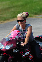 Sept. 3, 2011; Claremont, IN, USA: NHRA pro stock motorcycle rider Angie Smith during qualifying for the US Nationals at Lucas Oil Raceway. Mandatory Credit: Mark J. Rebilas-