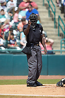 Home plate umpire James Jean makes a strike call during the South Atlantic League game between the Charleston RiverDogs and the Hickory Crawdads at L.P. Frans Stadium on May 13, 2019 in Hickory, North Carolina. The Crawdads defeated the RiverDogs 7-5. (Brian Westerholt/Four Seam Images)