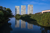 Fine Art, Landscape Travel Photograph of Tower Reflections of the Peninsula Towers casting their reflections on the Rio El Pitillal river as the morning sun rises.