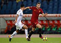 Roma's Edin Dzeko, left, is challenged by Bologna's  Giancarlo Gonzalez during the Serie A football match between Roma and Bologna at Rome's Olympic stadium, October 28, 2017.<br /> UPDATE IMAGES PRESS/Riccardo De Luca
