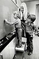 1978<br />  FILE PHOTO - ARCHIVES -<br /> <br /> Tim, teacher Helve Kaard and classmate Chris McMahon<br /> <br /> Bezant, Graham<br /> Picture, 1978,<br /> <br /> 1978<br /> <br /> PHOTO : Graham Bezant - Toronto Star Archives - AQP