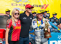 Jul 22, 2018; Morrison, CO, USA; NHRA funny car driver John Force (right) celebrates with daughter Courtney Force and her husband Graham Rahal after winning the Mile High Nationals at Bandimere Speedway. Mandatory Credit: Mark J. Rebilas-USA TODAY Sports