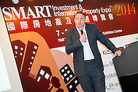 Adam Dockley, UK sales director of Henry Wiltshire, speaking at a seminar on UK property at the Smart International Property Investment Expo at the Hong Kong Convention and Exhibition Centre in Hong Kong. <br /> 07-08 June, 2014<br /> <br /> Photo by Tim O'Rourke / Sinopix