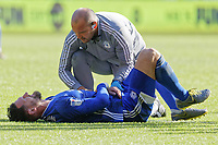 Sean Morrison of Cardiff City is seen to by a team physiotherapist during the Sky Bet Championship match between Swansea City and Cardiff City at the Liberty Stadium, Swansea, Wales, UK. Sunday 27 October 2019
