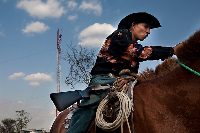 A cowboy in front of a new cell tower built to serve illegal communities in the Mayan Biosphere.
