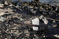"""Pictured: The spades and other tools used by the specialist crew clean up the oil spill that has reached the coast of Salamina, Greece<br />Re: An oil spill off Salamina island's eastern coast is spreading and has become """"an environmental disaster"""" according to local authorities in Greece.<br />The spill was caused by the sinking of the Aghia Zoni II tanker, carrying 2,200 metric tons of fuel oil and 370 metric tons of marine gas oil on Saturday, southwest of the islet of Atalanti near Psytalleia. According to reports, the coastline stretching from Kinosoura to the Selinia community has """"turned black"""" and authorities fear a new leak from the sunken ship.<br />According to the island's mayor, Isidora Papathanasiou, the weather """"turned on Sunday afternoon and brought the oil spill to Salamina."""""""