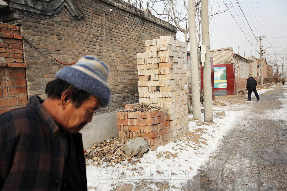 Piles of bricks in Dongzhuangying Village, on the southern outskirts of Beijing. Villagers have been building new extensions to their properties in-light of news that their village will be destroyed to make way for a new city airport. Villagers will be compensated more depending on the area of their homes, resulting in new buildings appearing across the village, as villagers anticipate higher amounts of compensation from local government. China. Friday 25th January, 2013.
