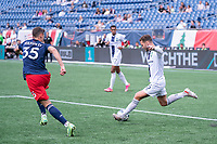 FOXBOROUGH, MA - JULY 4: Collin Verfurth #35 of the New England Revolution II tries to intercept a pass from Maxwell Hemmings #5 of Greenville Triumph SC near the New England Revolution II II goal during a game between Greenville Triumph SC and New England Revolution II at Gillette Stadium on July 4, 2021 in Foxborough, Massachusetts.