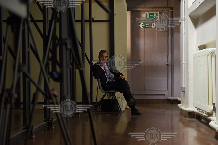 UKIP leader Nigel Farage takes a moment to rest during campaigning for the 7 May 2015 general election in the Haven High Academy in Boston, Lincolnsire.