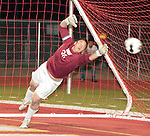 Goalie makes a diving attempt to stop the ball in a CIF SS Championship soccer game.