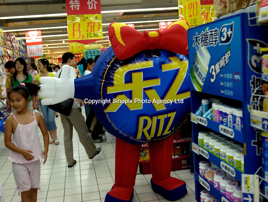 Ritz biscuits are on promotion in a Carrefour supermarket in Beijing, China. Major international chains like Carrefour and Walmart Stores have expanded aggressively in China. Local Chinese retailers have loudly protested this and lobbied heavily for protection from the new competition in price and service that these major retailers have set off..23 Jul 2006