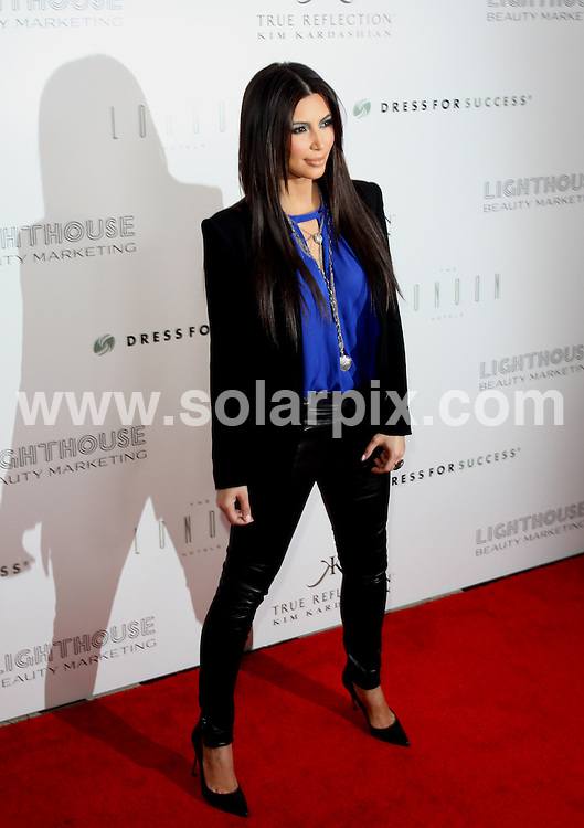 """**ALL ROUND PICTURES FROM SOLARPIX.COM**                                             **SYNDICATION RIGHTS FOR UK, AUSTRALIA, DENMARK, PORTUGAL, S. AFRICA, SPAIN & DUBAI (U.A.E) & ASIA (EXCLUDING JAPAN) ONLY**                                                                                  Caption:  Kim Kardashian """"True Reflection"""" Fragrance Launch Party Benefiting Dress for Success - Arrivals - The London Hotel, 1020 N. San Vicente Boulevard - West Hollywood, CA, USA                                       .This pic: Kim Kardashian                                                                                             JOB REF: 14606       PHZ/Burris       DATE:23.03.2012                                                            **MUST CREDIT SOLARPIX.COM OR DOUBLE FEE WILL BE CHARGED**                                                                      **MUST AGREE FEE BEFORE ONLINE USAGE**                               **CALL US ON: +34 952 811 768 or LOW RATE FROM UK 0844 617 7637**"""