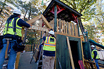 Workers add the sign Paul Gramuglia dream, Fort Paul, a large playscape in his backyard,    as a wish comes true for the 6-year-old who is confined to a wheel chair courtesy of Make-A-Wish,  Friday, Oct. 25, 20107, at their South Windsor home. (Jim Michaud / Journal Inquirer)