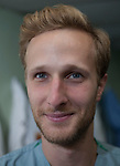 """Evan Prokuski, RN, from Chicago, has six years experience in MICU and OR. This is his first mission with Project Hope, and first experience working and living on a U.S. Navy Ship. While onboard he is assigned to DSS. <br /> In the coming year, he plans to attend school to become a CRNA. <br /> <br /> """"It's been great...I am doing what I signed up to do, and working with DSS, delivering care, learning and working side-by-side with different people, has been great. I'd like to return to do more missions after I complete school."""""""