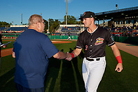 Batavia Muckdogs Nic Ready (3) shakes hands with Booster Club President Hal Mitchell during a pre-game awards ceremony before a NY-Penn League game against the Auburn Doubledays on August 31, 2019 at Dwyer Stadium in Batavia, New York.  Auburn defeated Batavia 12-5.  (Mike Janes/Four Seam Images)