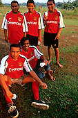 Altamira, Brazil. Football; members of the Campealta Co-operative football team wearing Nike Arsenal football shirts.