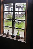 Botttles onm window at Fort Ross. California