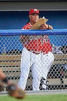 Batavia Muckdogs hitting coach Luis Quinones (19) during a game against the Aberdeen Ironbirds on July 15, 2016 at Dwyer Stadium in Batavia, New York.  Aberdeen defeated Batavia 4-2. (Mike Janes/Four Seam Images)