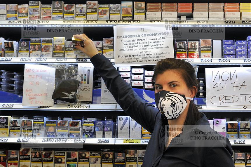 - epidemia di Coronavirus, vivere con la mascherina, la tabaccheria, Milano, Aprile 2020<br /> <br /> - Coronavirus epidemic, live with the mask, the tobacconist's shop, Milan, April 2020