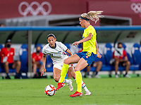TOKYO, JAPAN - JULY 21: Christen Press #11 of the USWNT defends Filippa Angeldal #16 of Sweden during a game between Sweden and USWNT at Tokyo Stadium on July 21, 2021 in Tokyo, Japan.