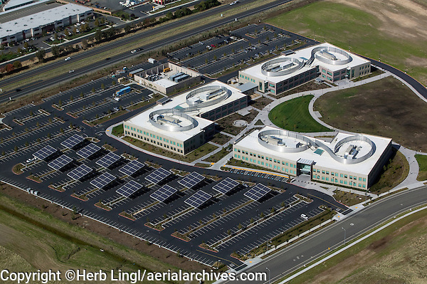 aerial view above solar panels placed in parking lot commercial office building Vacaville California