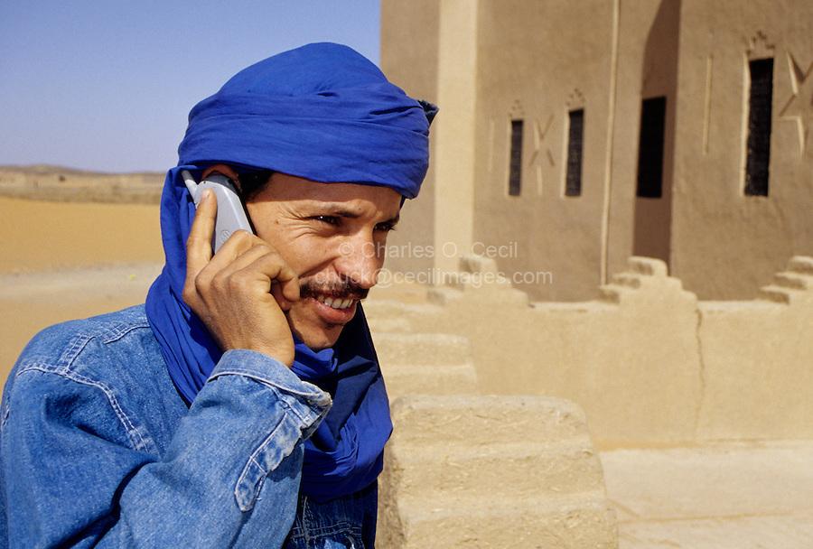 Near Erfoud, Morocco - Berber Using Cell Phone.