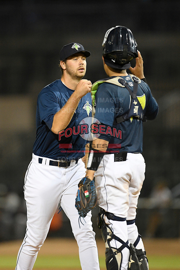 Pitcher Tylor Megill (35) of the Columbia Fireflies greets catcher Juan Uriarte in a game against the Rome Braves on Tuesday, June 4, 2019, at Segra Park in Columbia, South Carolina. Columbia won, 3-2. (Tom Priddy/Four Seam Images)