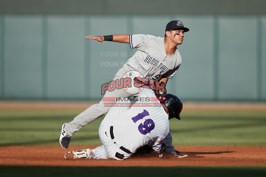 Samir Duenez (19) of the Winston-Salem Dash slides into second base ahead of the tag by Luis Santos (6) of the Hudson Valley Renegades at Truist Stadium on August 28, 2021 in Winston-Salem, North Carolina. (Brian Westerholt/Four Seam Images)