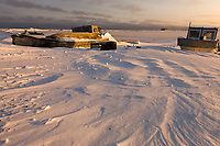 Boats along the shores of Barter Island in the village of Kaktovik, Alaska.