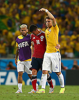 Dani Alves and David Luiz of Brazil consoles a tearful James Rodriguez of Colombia at full time