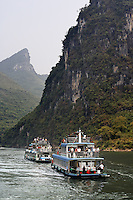 Boats cruising the Lijiang River, Guanxi, China