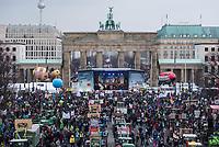"""Mehrere zehntausend Menschen demonstrierten am Samstag den 19. Januar 2019 in Berlin unter dem Motto """"Wir haben es statt!"""" fuer eine Wende in der Agrarpolitik. Sie forderten eine Abkehr von der Subventionierung der industriellen Landwirtschaft, hin zu einer Unterstuetzung der kleinen Betriebe. """"Schluss mit den Steuermilliarden an die Agrarindustrie!"""" und """"Subventionen nur noch fuer umwelt- und klimaschonende Landwirtschaft! Oeffentliche Gelder nur noch fuer artgerechte Tierhaltung!"""".<br /> An dem Demonstrationszug nahmen Bauern mit 141 Traktoren teil.<br /> 19.1.2019, Berlin<br /> Copyright: Christian-Ditsch.de<br /> [Inhaltsveraendernde Manipulation des Fotos nur nach ausdruecklicher Genehmigung des Fotografen. Vereinbarungen ueber Abtretung von Persoenlichkeitsrechten/Model Release der abgebildeten Person/Personen liegen nicht vor. NO MODEL RELEASE! Nur fuer Redaktionelle Zwecke. Don't publish without copyright Christian-Ditsch.de, Veroeffentlichung nur mit Fotografennennung, sowie gegen Honorar, MwSt. und Beleg. Konto: I N G - D i B a, IBAN DE58500105175400192269, BIC INGDDEFFXXX, Kontakt: post@christian-ditsch.de<br /> Bei der Bearbeitung der Dateiinformationen darf die Urheberkennzeichnung in den EXIF- und  IPTC-Daten nicht entfernt werden, diese sind in digitalen Medien nach §95c UrhG rechtlich geschuetzt. Der Urhebervermerk wird gemaess §13 UrhG verlangt.]"""