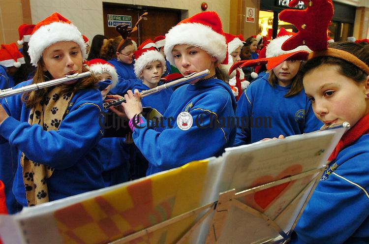 L-R Alice Twomey (12), Aoife O'Dwyer (11) and Tessa Doran (11) CBS Christmas Carol singing at Dunnes Mall in aid of St Josephs Hospital.Pic Arthur Ellis.