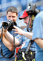 8 June 2010: Photographer Mark Goldman shows an image to UPI photographer Kevin Dietsch prior to a game between the Washington Nationals and the Pittsburgh Pirates at Nationals Park in Washington, DC. The Nationals defeated the Pirates 5-2 in the series opener where pitching sensation Stephen Strasburg made his Major League debut, striking out 14 batters and notching his first win in the majors. Mandatory Credit: Ed Wolfstein Photo