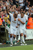 Andre Ayew of Swansea City celebrates his equaliser with team mates Leroy Fer and Jefferson Montero during the Swansea City FC v Manchester City Premier League game at the Liberty Stadium, Swansea, Wales, UK, Sunday 15 May 2016