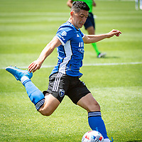 SAN JOSE, CA - APRIL 24: Cristian Espinoza #10 of the San Jose Earthquakes passes the ball during a game between FC Dallas and San Jose Earthquakes at PayPal Park on April 24, 2021 in San Jose, California.