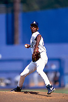 Ramon Martinez of the Los Angeles Dodgers during a game at Dodger Stadium in Los Angeles, California during the 1997 season.(Larry Goren/Four Seam Images)