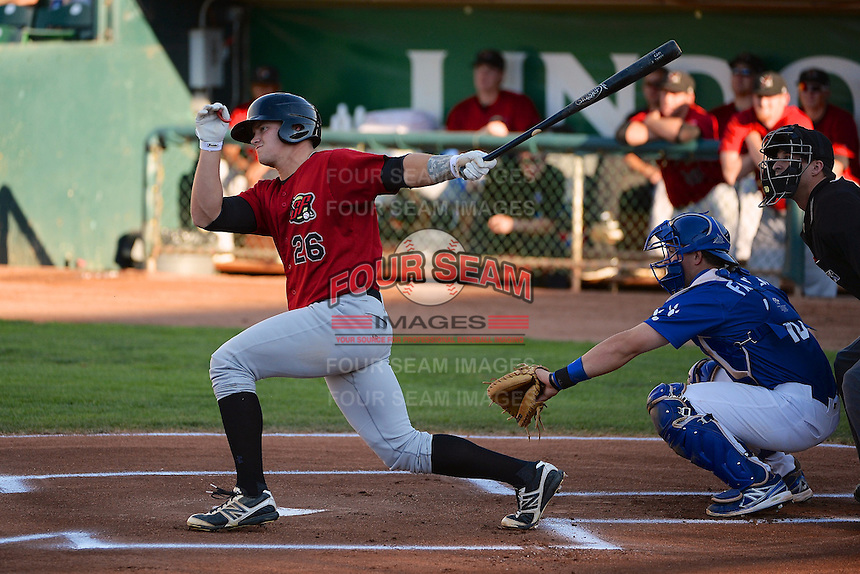 Adam Engel (26) of the Great Falls Voyagers at bat against the Ogden Raptors  with Raptors catcher Austin Cowen (15) in Pioneer League play  at Lindquist Field on August 13, 2013 in Ogden Utah. (Stephen Smith/Four Seam Images)
