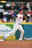 Buffalo Bisons shortstop Ryan Goins (10) turns a double play during a game against the Pawtucket Red Sox on August 23, 2014 at Coca-Cola Field in Buffalo, New  York.  Buffalo defeated Pawtucket 15-2.  (Mike Janes/Four Seam Images)