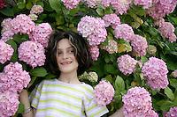 Young girl amongst the hydrangeas, Istanbul, Turkey